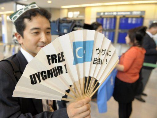 China Uighur Protester w Fan Sign