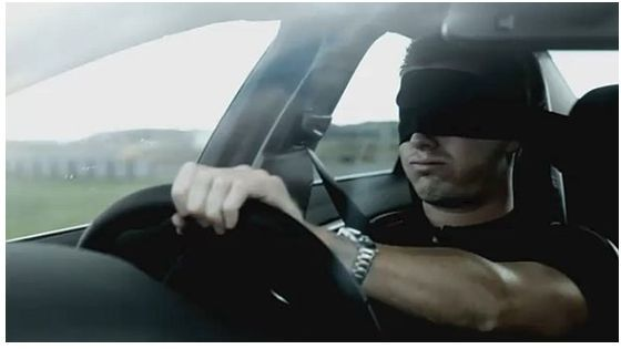 blindfold while driving a car at the wheel